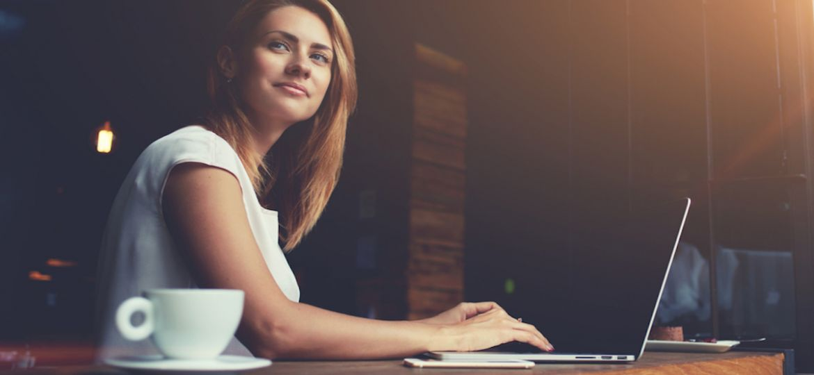 Successful woman in HR career working on laptop in modern workplace