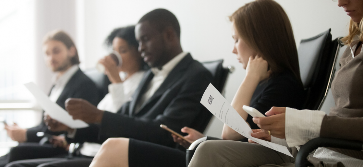 An office filled with a group of high value job seekers waiting to be interviewed, after finding a company based on their candidate attraction strategies.