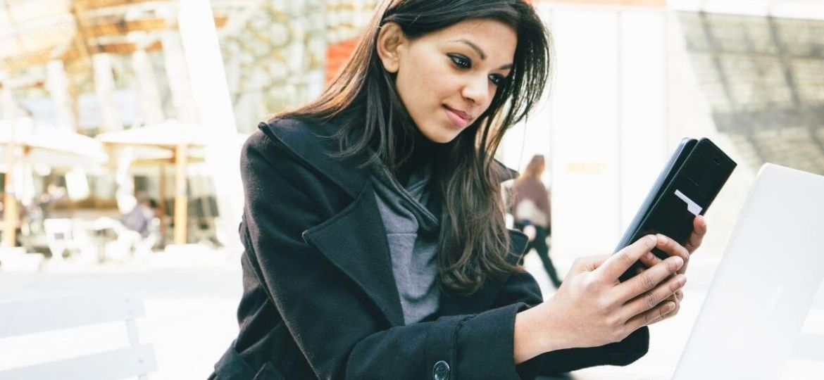 Young woman watching videos on her mobile phone